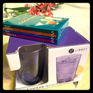 Set of glasses and mixed drink recipe books